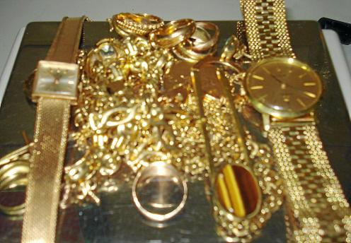 FILE PHOTO: French President Hollande and economy advisor Macron walk in the Elysee Palace in Paris